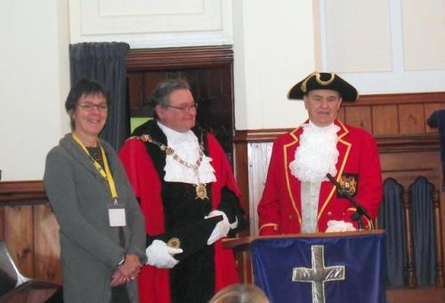 High Bailiff Fred Dowling, shown sharing the podium with CAB outreach worker Eve England and Henley Town Crier Gordon Trinder.