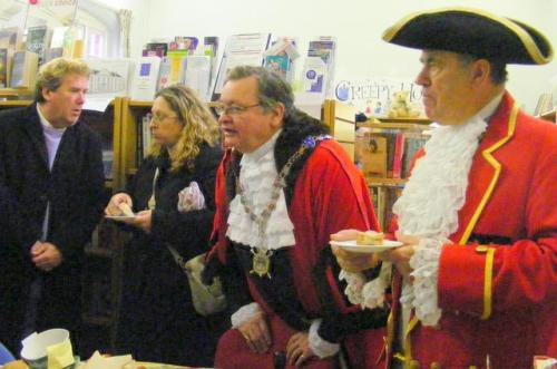 County Councillor Mike Perry discusses issues with Food Bank Chairman Elaine Field and the High Bailiff and Town Crier judge the quality of the food display.