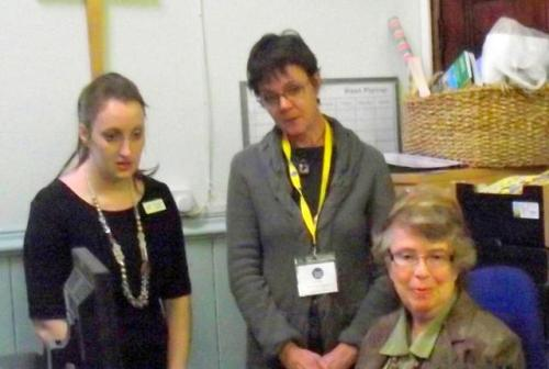 Helen Kendrick, Oribt Heart of England Community Investment Officer, views the CAB website with Eve England and Library director Judith Lindley.