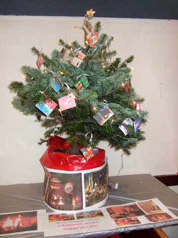 Our tree at St John's:  Christmas stories 'round the fire